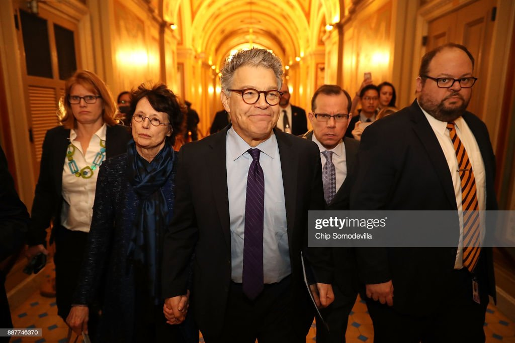 Sen. Al Franken (D-MN) (C) and his wife Franni Bryson (L) arrive at the U.S. Capitol Building December 7, 2017 in Washington, DC. Franken announced that he will be resigning in the coming weeks after being accused by several women of sexual harrassment.