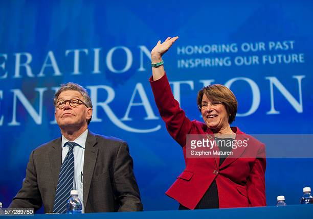 Sen Al Franken and Sen Amy Klobuchar greet the crowd before Democratic Presidential candidate Hillary Clinton's speech at the Minneapolis Convention...