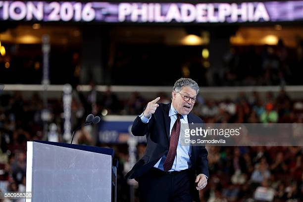 Sen Al Franken gestures to the crowd as he delivers remarks on the first day of the Democratic National Convention at the Wells Fargo Center July 25...