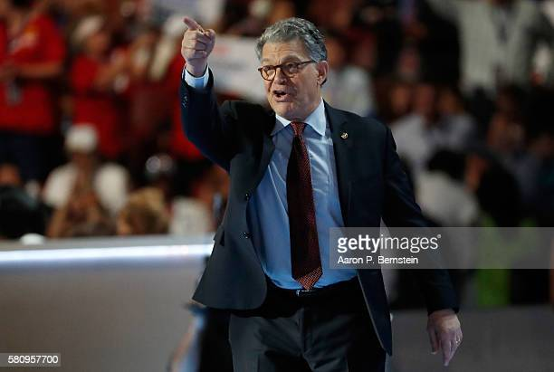 Sen Al Franken gestures to the crowd as he walks on stage to deliver remarks on the first day of the Democratic National Convention at the Wells...