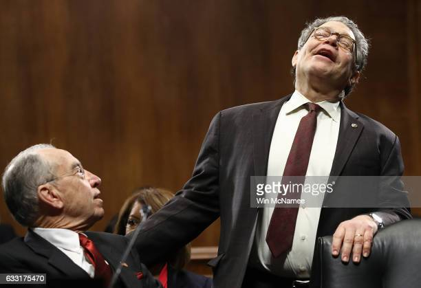 Sen Al Franken jokes with Committee Chairman Sen Chuck Grassley prior to the start of the Senate Judiciary Committee's 'markup' on the nomination of...