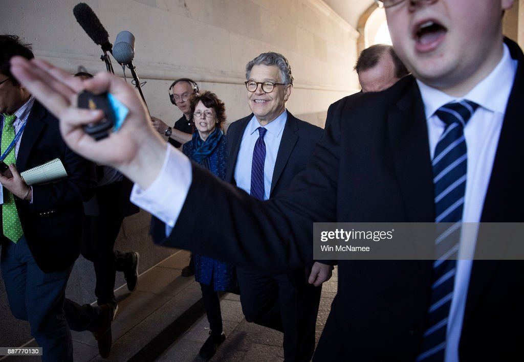 Sen. Al Franken (C) ) (D-MN) leaves the U.S. Capitol with his wife Franni Bryson (L) after speaking on the floor of the U.S. Senate December 7, 2017 in Washington, DC. Franken announced that he will be resigning from the U.S. Senate in the coming weeks following a barrage of allegations related to inappropriate conduct with women.