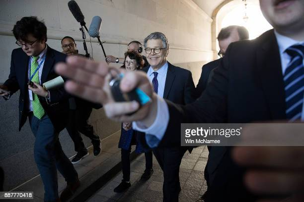 Sen Al Franken leaves the US Capitol with his wife Franni Bryson after speaking on the floor of the US Senate December 7 2017 in Washington DC...
