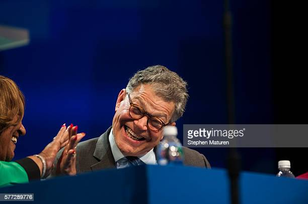 Sen Al Franken reacts during Democratic Presidential candidate Hillary Clinton's speech at the Minneapolis Convention Center on July 18 2016 in...