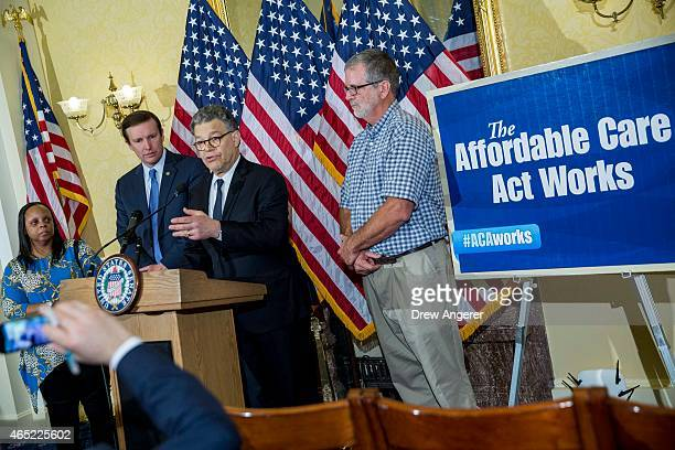Sen Al Franken speaks next to Vanita Johnson and Terry Donald both beneficiaries of the Affordable Care Act and Sen Chris Murphy at a news conference...