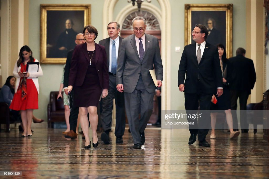 Sen. Amy Klbuchar (D-MN), Sen. Jeff Merkley (D-OR), Senate Minority Leader Charles Schumer (D-NY) and Sen. Greg Peters (D-MI) prepare to talk to reporters following the weekly Senate Democratic policy luncheon at the U.S. Capitol May 15, 2018 in Washington, DC. U.S. President Donald Trump joined Senate Republicans during their luncheon and talked about the robust economy and the opening of the new U.S. embassy in Jerusalem.
