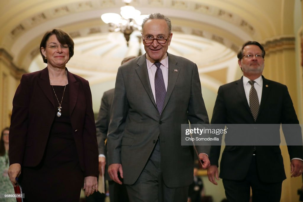 Sen. Amy Klbuchar (D-MN), Senate Minority Leader Charles Schumer (D-NY) and Sen. Greg Peters (D-MI) prepare to talk to reporters following the weekly Senate Democratic policy luncheon at the U.S. Capitol May 15, 2018 in Washington, DC. U.S. President Donald Trump joined Senate Republicans during their luncheon and talked about the robust economy and the opening of the new U.S. embassy in Jerusalem.