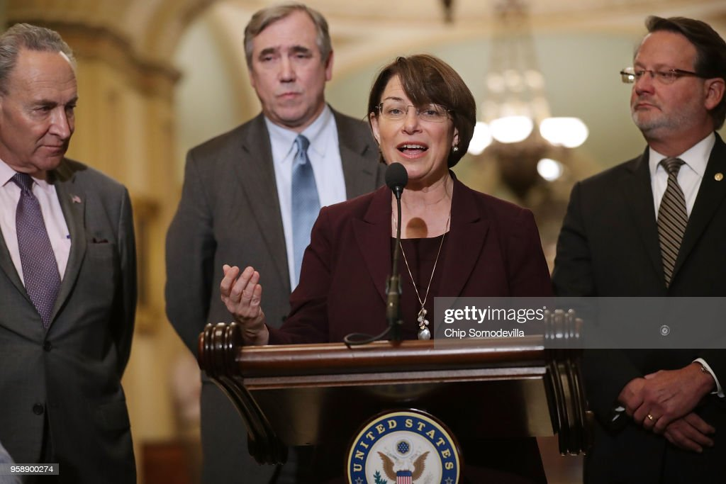 Sen. Amy Klbuchar (D-MN) (3rd L) talks to reporters following the weekly Senate Democratic policy luncheon with (L-R) Senate Minority Leader Charles Schumer (D-NY), Sen. Jeff Merkley (D-OR) and Sen. Greg Peters (D-MI) at the U.S. Capitol May 15, 2018 in Washington, DC. U.S. President Donald Trump joined Senate Republicans during their luncheon and talked about the robust economy and the opening of the new U.S. embassy in Jerusalem.