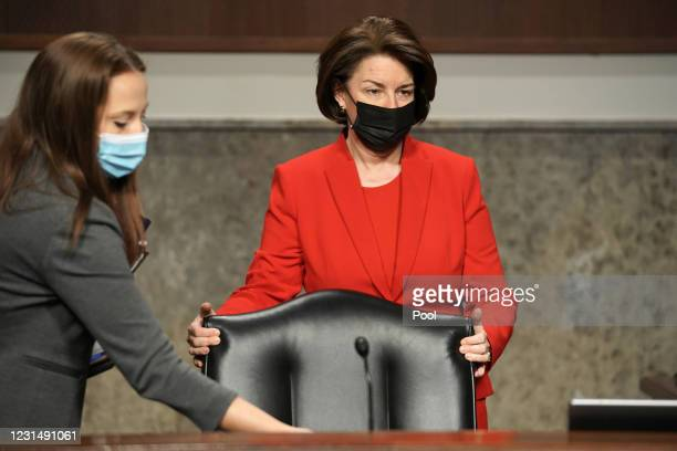 Sen. Amy Klobuchar arrives to a Senate Homeland Security and Governmental Affairs & Senate Rules and Administration joint hearing to discuss the...