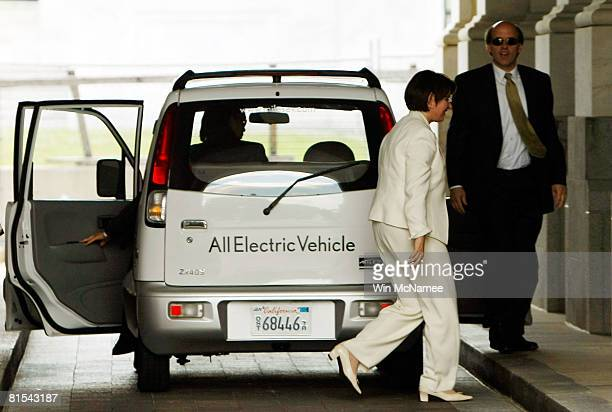 Sen Amy Klobuchar exits a Miles Electric Vehicle after test driving it to the US Capitol June 12 2008 in Washington DC Earlier Klobuchar joined Sen...