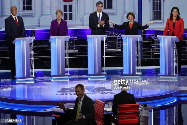 Sen Amy Klobuchar gestures while the moderators Chuck Todd of NBC News and Rachel Maddow of MSNBC experience technical difficulties during the first...