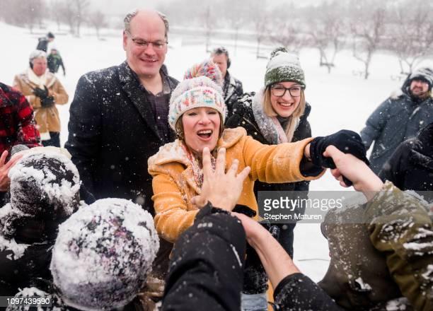 Sen Amy Klobuchar greets supporters with her husband John Bessler and her daughter Abigail Bessler after announcing her presidential bid at Boom...