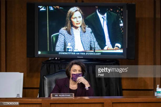 Sen. Amy Klobuchar listens while Supreme Court nominee Judge Amy Coney Barrett testifies before the Senate Judiciary Committee on the third day of...