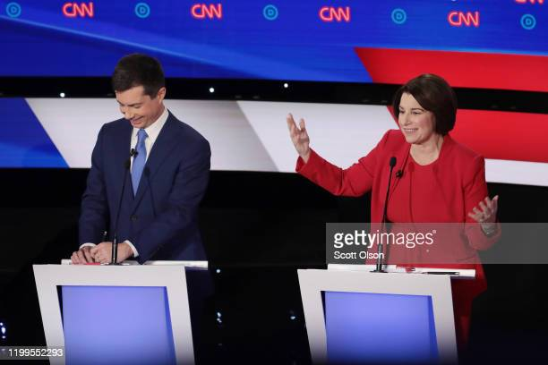 Sen Amy Klobuchar makes a point as former South Bend Indiana Mayor Pete Buttigieg reacts during the Democratic presidential primary debate at Drake...