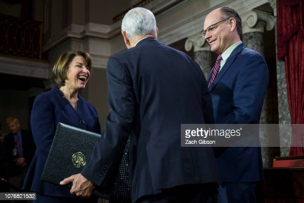 Sen Amy Klobuchar participates in a mock swearing in ceremony with Vice President Mike Pence on Capitol Hill on January 3 2019 in Washington DC