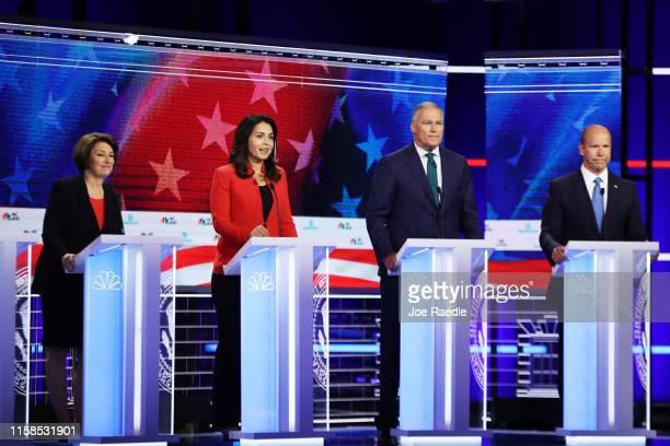 Sen Amy Klobuchar Rep Tulsi Gabbard Washington Gov Jay Inslee and former Maryland congressman John Delaney take part in the first night of the...