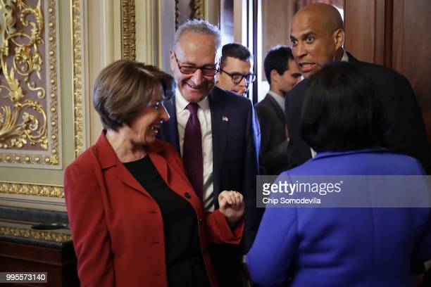 Sen Amy Klobuchar Senate Minority Leader Charles Schumer Sen Cory Booker and Sen Mazie Hirono leave their caucus luncheon meeting at the US Capitol...