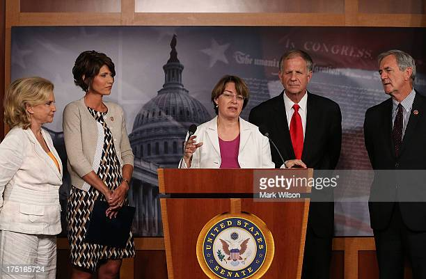 S Sen Amy Klobuchar speaks about sex slave industry while flanked by US Rep Carolyn Maloney US Rep Kristi Noem US Rep Ted Poe and US Rep Rick Nolan...
