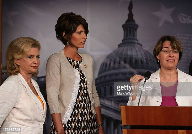 S Sen Amy Klobuchar speaks about sex slave industry while flanked by US Rep Carolyn Maloney and US Rep Kristi Noem during a news conference on...