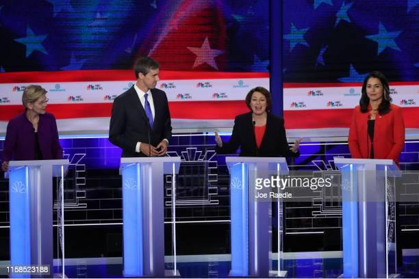 Sen Amy Klobuchar speaks as Sen Elizabeth Warren former Texas congressman Beto O'Rourke and Rep Tulsi Gabbard look on during the first night of the...