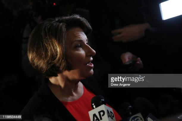 Sen Amy Klobuchar speaks to the media in the spin room after the first night of the Democratic presidential debate on June 26 2019 in Miami Florida A...
