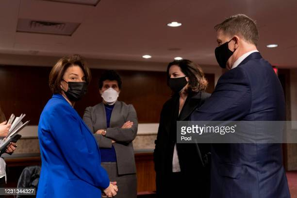 Sen. Amy Klobuchar speaks with former U.S. Capitol Police Chief Steven Sund following a Senate Homeland Security and Governmental Affairs and Senate...