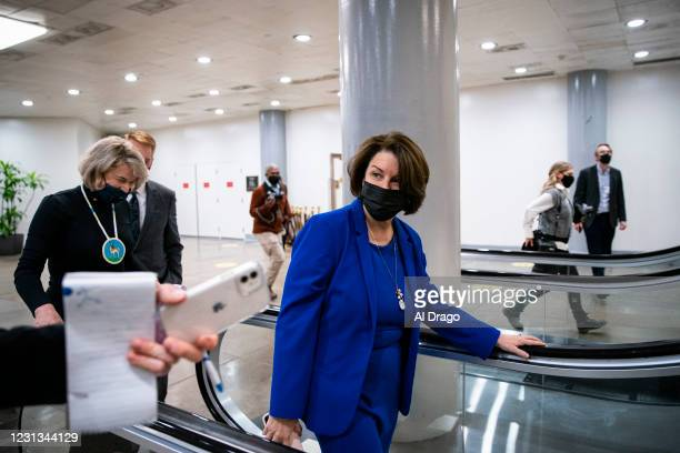 Sen. Amy Klobuchar speaks with reporter as she arrives for a vote in the subway of the U.S. Capitol on February 23, 2021 in Washington, DC. The...