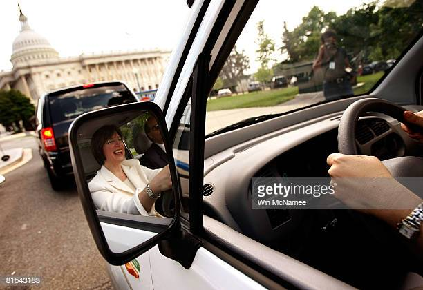 Sen Amy Klobuchar test drives a Miles Electric Vehicle to the US Capitol June 12 2008 in Washington DC Earlier Klobuchar joined Sen Harry Reid and...