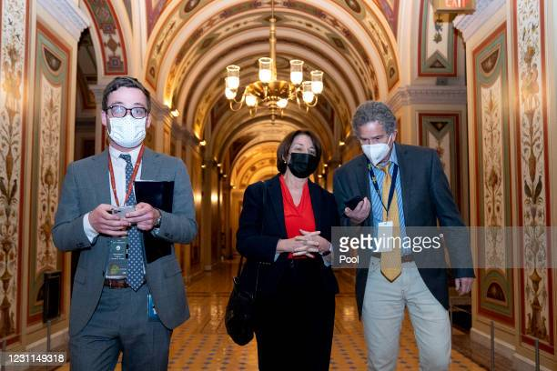 Sen. Amy Klobuchar wears a protective mask while speaking to members of the media at the U.S. Capitol on February 13, 2021 in Washington, D.C. Former...