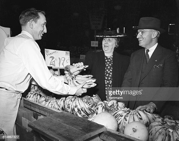 Sen and Mrs Harry Truman S Truman learn from clerk Joseph Wood that OPA maximum price regulations went into effect allowing 2 pounds of bananas to...