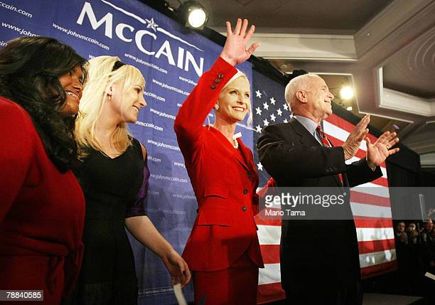 S Sen and Republican presidential contender John McCain celebrates with his wife Cindy and daughters Bridget and Meghan after winning the Republican...