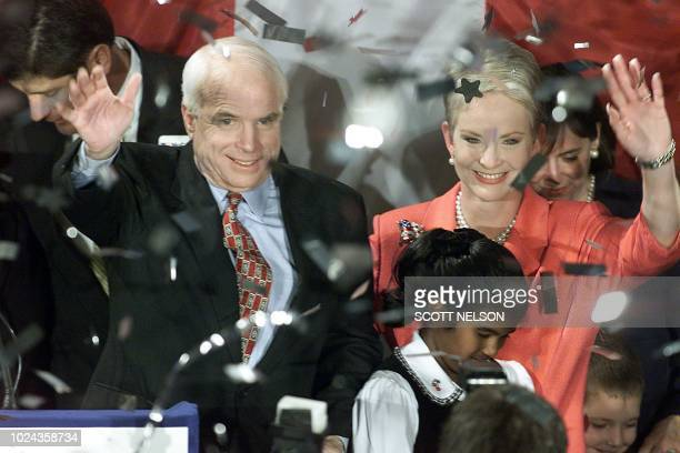 US Sen and Republican presidential hopeful John McCain and his wife Cindy greet supporters at the Pacific Design Center in Los Angeles 07 March 2000...