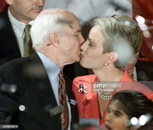 US Sen and Republican Presidential hopeful John McCain kisses his wife Cindy after he addressed supporters at the Pacific Design Center in Los...