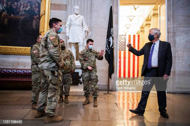 Sen. Angus King, I-Maine, talks with New York National Guard troops in the Capitol Rotunda on the third day of the impeachment trial of former...