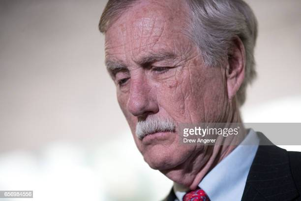 Sen Angus King pauses while answering questions from reporters following a closed briefing with the Senate Select Committee on Intelligence...