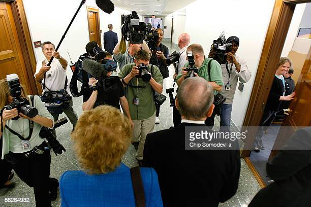Sen Arlen Specter and is wife Joan are followed by members of the news media throught the halls of the Dirksen Senate Office Building April 28 2009...
