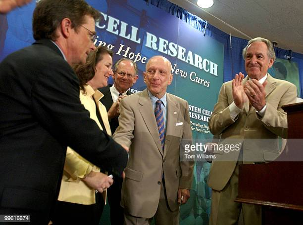 Sen Arlen Specter RPa shakes hands with actor Michael J Fox during a news conference which urged passage of legislation designed to expand the...