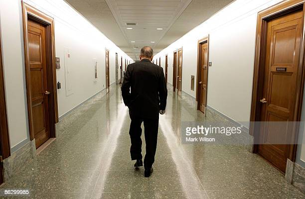 Sen Arlen Specter walks down a hall in the Dirksen Senate Office Building after leaving attending a Senate Appropriations Committee hearing on...