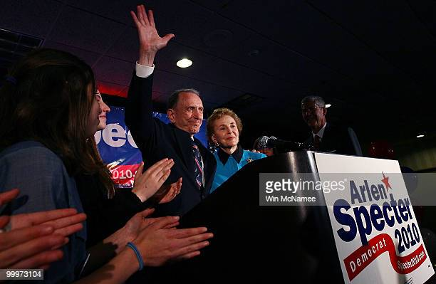 Sen Arlen Specter waves goodbye after conceding defeat at a primary night gathering of supporters and staff with his wife Joan Specter and family...