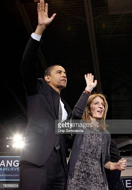Sen Barack Obama and Caroline Kennedy wave to supporters during a rally in the Bender Arena at American University January 28 2008 in Washington DC...