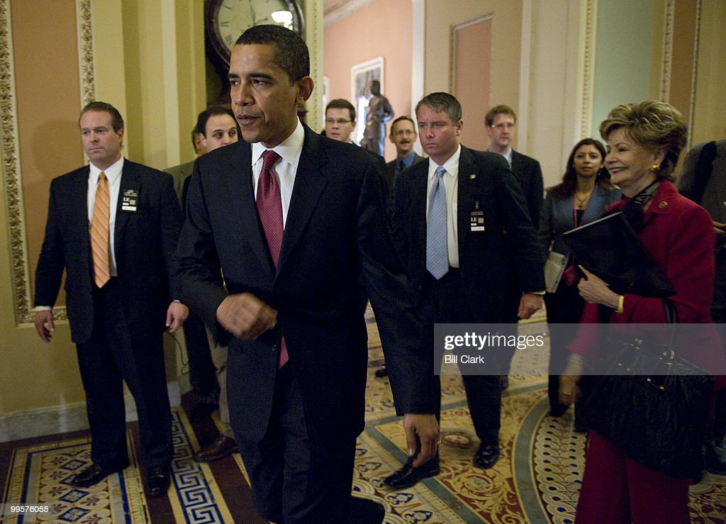 Sen. Barack Obama, D-Ill., walks through the Ohio Clock Corridor in the U.S. Capitol as he makes his way back to the Senate side after visiting the House Floor on Thursday, May, 8, 2008. To the right is Del. Madeleine Z. Bordallo, D-Guam, who walked with Sen. Obama form the House side.