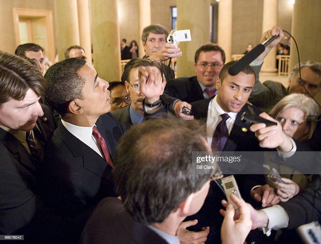 Sen. Barack Obama, D-Ill., walks through the U.S. Capitol surrounded by reporters and photographers as he makes his way back to the Senate side after visiting the House Floor on Thursday, May, 8, 2008.