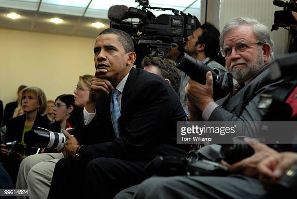 Sen Barack Obama DIll watches a film made by actor George Clooney and his father at the National Press Club at 'SAVE DARFUR Rally to Stop Genocide'...