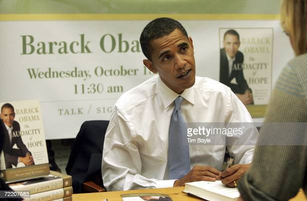 """Sen. Barack Obama signs a copy of his new book """"Audacity of Hope"""" at the Barnes & Noble bookstore October 18, 2006 in Skokie, Illinois. Obama is in..."""