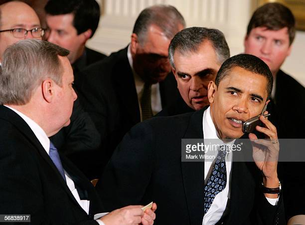 Sen. Barack Obama talks on a phone while seated next to Sen. Richard J. Durbin during an event honoring the 2005 World Series Champion Chicago White...