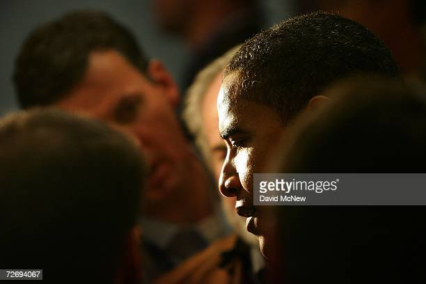Sen Barack Obama talks with reporters as he leaves the second annual Global Summit on AIDS and The Church at Saddleback Church December 1 2006 in...
