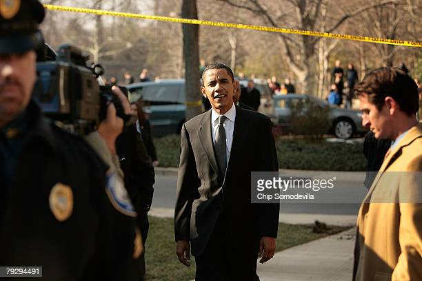 Sen Barack Obama walks outside to address an overflow crowd outside a rally at the Bender Arena at American University January 28 2008 in Washington...