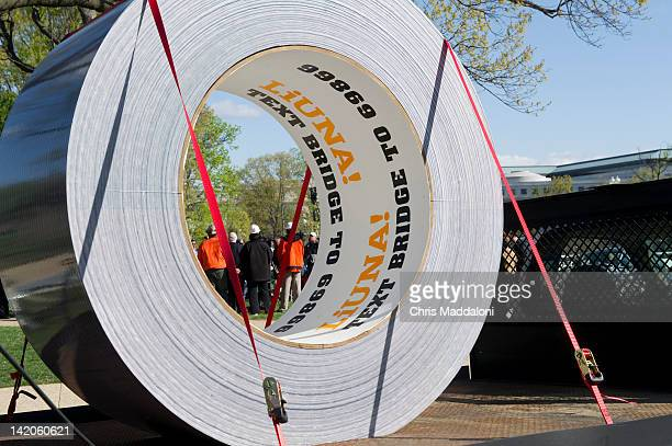 Sen Barbara Boxer DCa and Sen Ben Cardin DMd hold a news conference on passage of the Highway bill with a giant roll of duct tape from the Laborers'...
