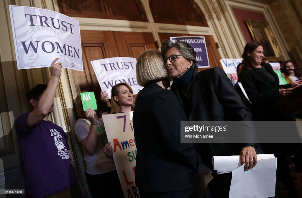 U.S. Sen. Barbara Boxer (R) (D-CA) embraces Sen. Patty Murray (L) (D-WA) after speaking at a press conference advocating women's health rights January 21, 2015 at the U.S. Capitol in Washington, DC. Boxer spoke with women's health advocates 'to denounce attacks on women's health and Roe v. Wade in advance of the 42nd anniversary of the landmark Supreme Court decision.