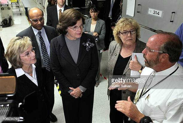 US Sen Barbara Boxer Sen Dianne Feinstein and US Rep Zoe Lofgren look on as Stion CEO Chet Ferris leads them on a tour of the Stion production...